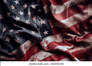 Grunge crumpled american flag background with dirt and blood