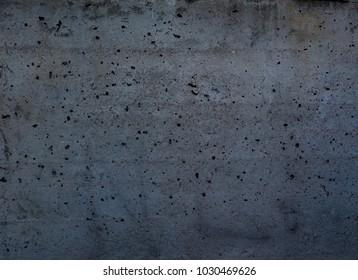 grunge dark grey concrete texture useful as a background