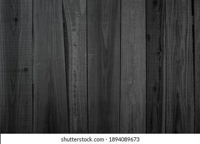Grunge dark old wood texture background. Vintage black wooden board wall antique cracking old style background objects for furniture design. Painted weathered peeling table wood hardwood decoration.