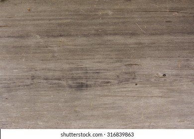 Grunge dark wooden background with old rough timber. Grey brown color. Rustic style. Close up photo from a building in a russian countryside