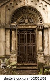 grunge door to the tomb on cemetery