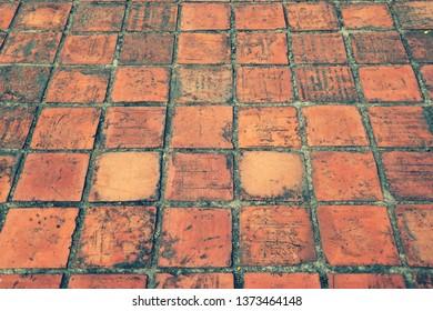 Grunge earthenware tile floor as texture pattern background
