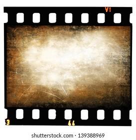 Grunge filmstrip texture, scratched photo film frame on white background
