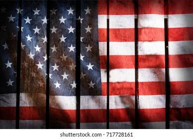 Grunge filtered,USA national flag on wood background.