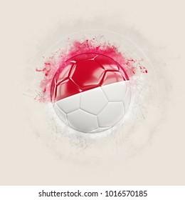 Grunge football with flag of monaco. 3D illustration