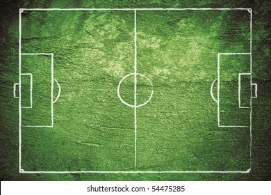 Grunge football (soccer) field with chalk drawn lines.