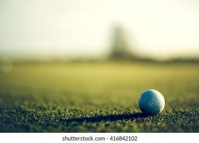 Grunge golf ball on course