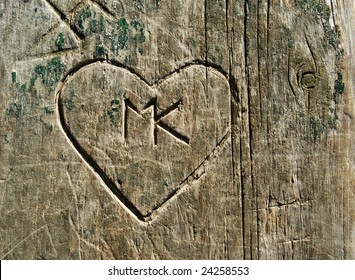 Grunge Graffiti Heart carved into wooden plank