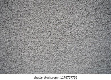 Grunge grainy grey background. Concrete grainy texture