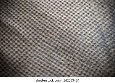 Grunge holed creased canvas background od texture