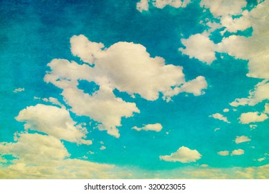 Grunge image of blue sky with white clouds.