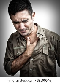 Grunge image of a man having a chest pain or heart attack