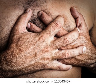 Grunge image of a topless man suffering a heart attack
