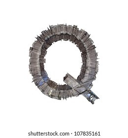 Grunge metal letter Q isolated on white. With clipping path