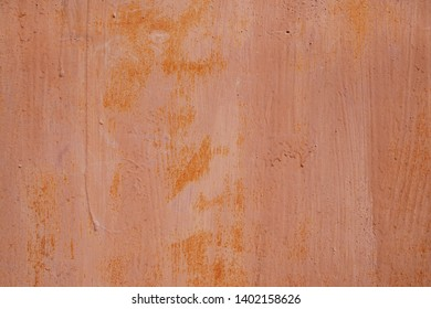 Grunge metal wall background of red brown painted garage. Copy space