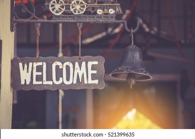 grunge metal welcome sign hanging. selective focus.
