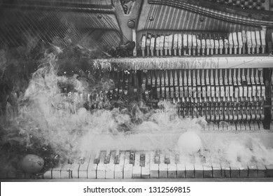 grunge music background of old piano in smoke