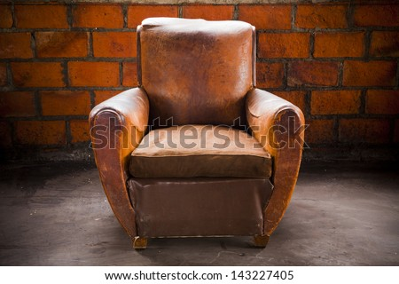Gentil The Grunge Old Armchair With Top Hi Light Over The Brick Wall