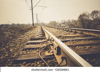 Grunge old railroad tracks close up background.