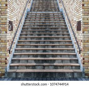 Grunge orange cement staircase brick wall