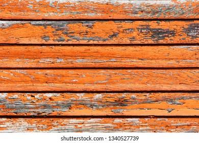 Grunge orange peeling paint wood texture.