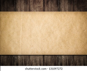 Grunge paper on wooden background