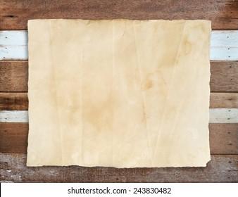 Grunge paper texture on vintage wooden background.