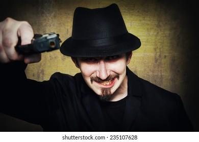 Grunge portrait of an insane gangster
