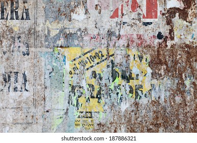 grunge ripped poster background - texture of torn advertisement on an old rusty billboard panel