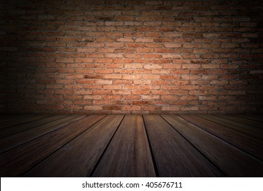Grunge room with wooden floor and red brick wall background