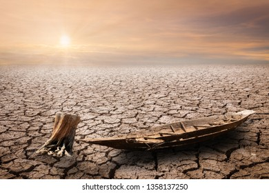 Grunge row boat over Land with dry and cracked ground. Desert,Global warming background concept