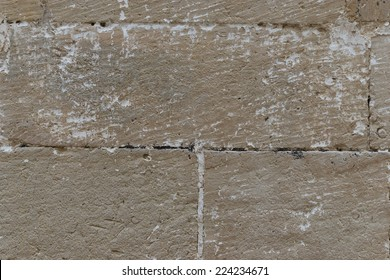Grunge sandstone background texture. Old stained wall.