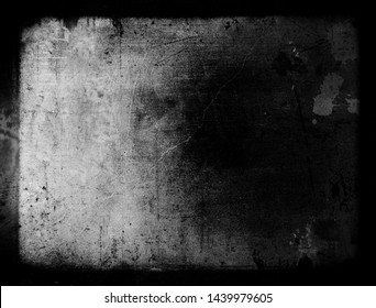 Grunge scratched background, old distressed scary texture with black frame, old film effect