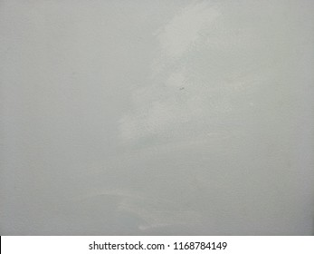 Grunge and scratched grey wall with white spots for textured abstract background and for your text or other design element.