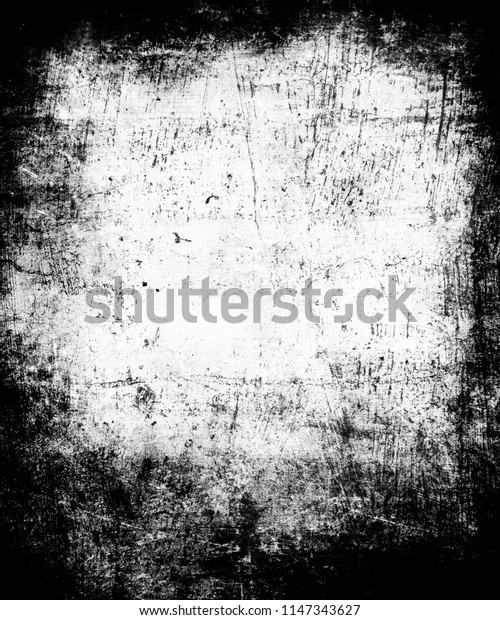 Grunge scratched scary horror background, distressed black and white texture