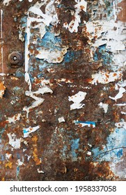 Grunge shabby texture bavkground. Rusty metal mailbox with peeling paint and paper. Blue, white, brown