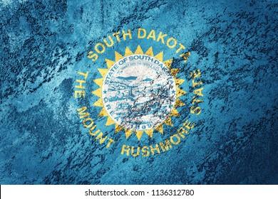Grunge South Dakota state flag. South Dakota flag background grunge texture.