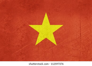 Grunge sovereign state flag of country of Vietnam in official colors.