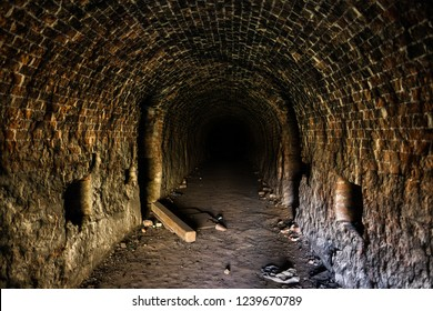 Grunge, spooky arched corridor in an abandoned brick building, urban exploration, haunted tunnel scary looking place.