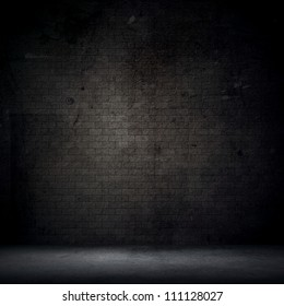 Grunge style interior with brick wall and concrete floor