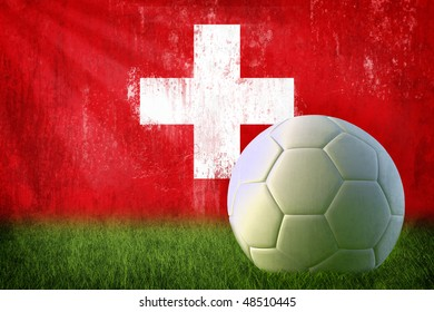 Grunge Swiss flag on wall and soccer ball