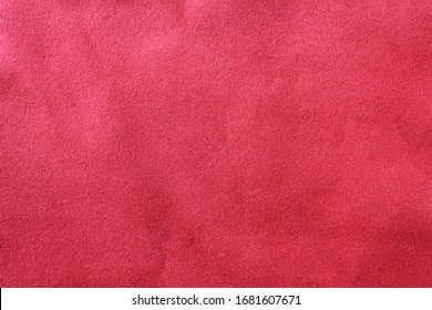 Grunge texture background of dirty dark red fabric surface. Empty burgundy color cloth, old faded crumpled material, vintage style velvet textile fragment with blank copy space