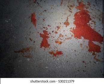 Grunge texture of blood stain on concrete wall with spotlight effect in the middle of the picture