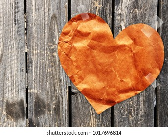 Grunge valentine background with paper heart on old wooden wall. Mock up template. Copy space for your text