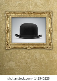 grunge wallpaper with golden vintage frame and a bowler hat