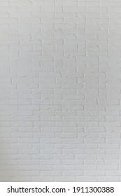 Grunge white brick backdrop. Surface of gray brick wall