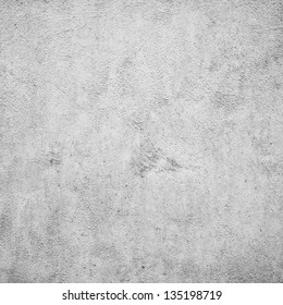 Grunge white plaster or concrete texture or background.