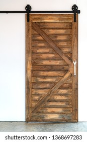 The grunge wood barn door.