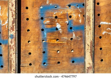 grunge wooden panel with holes