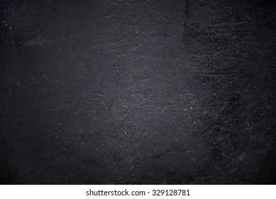 Grungy black textured metal background